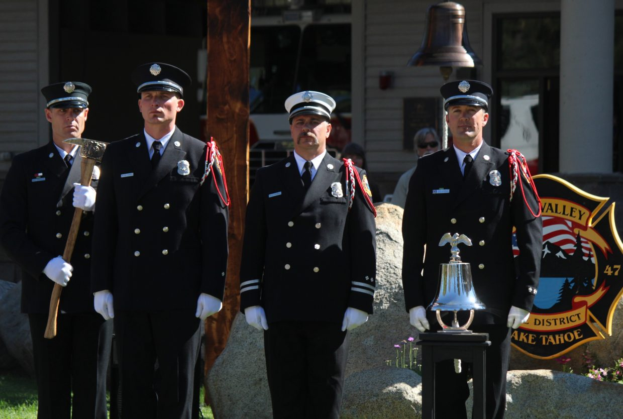 The Lake Valley Fire Protection District Honor Guard stands at attention.