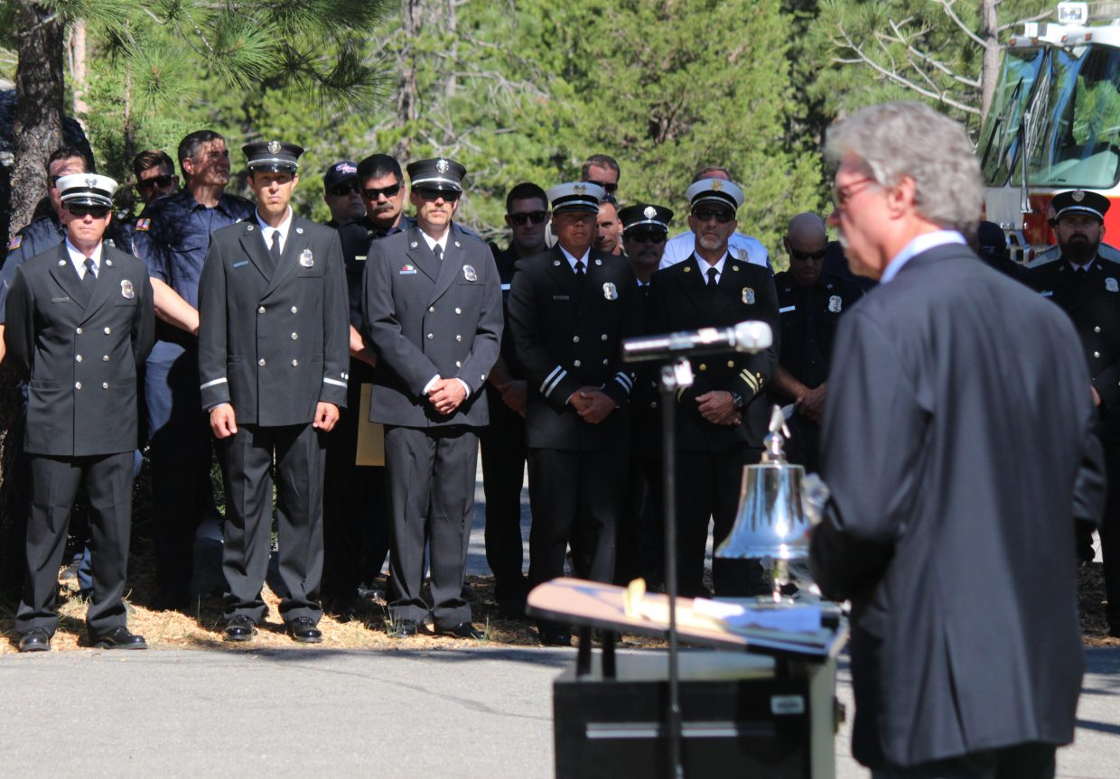 Bob Bettencourt, chairperson of the Lake Valley Fire Protection District Board of Directors, speaks as area firefighters stand in the background during a ceremony marking the 10th anniversary of the Angora Fire on Saturday, June 24.