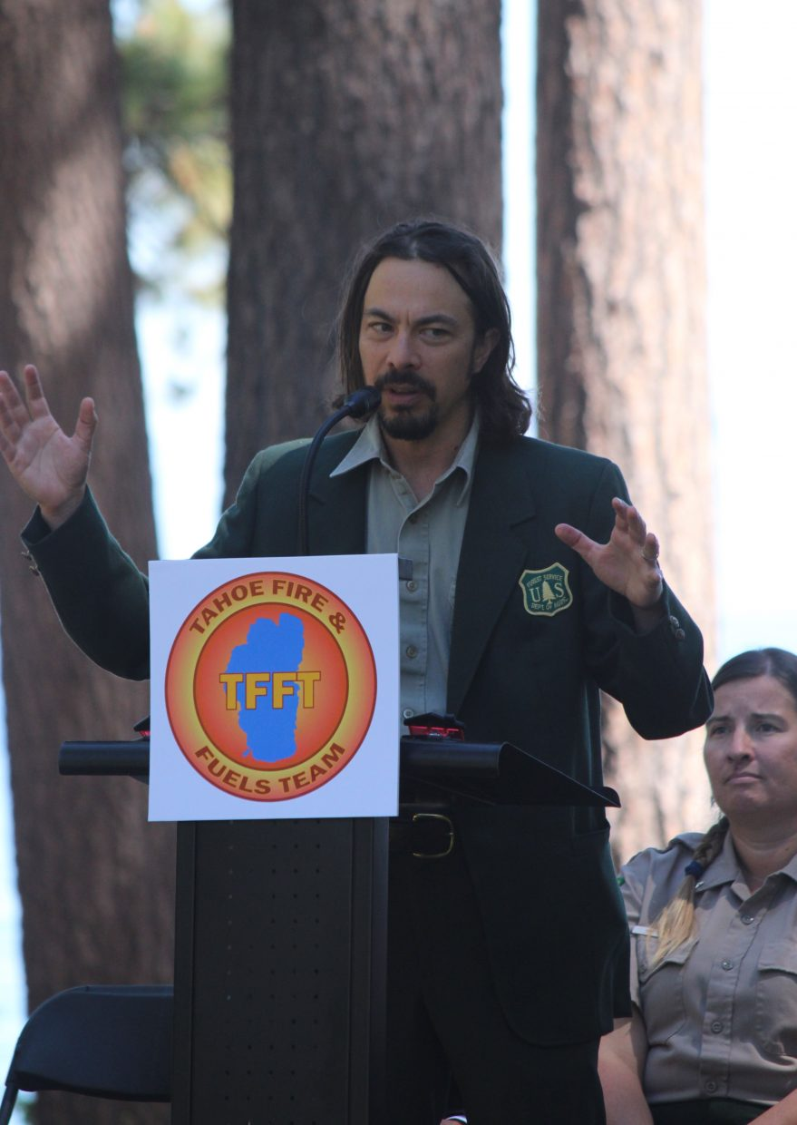 Eli Ilano, forest supervisor for the Tahoe National Forest, speaks to a small crowd gathered on the Valhalla Grand Lawn Saturday, June 24.