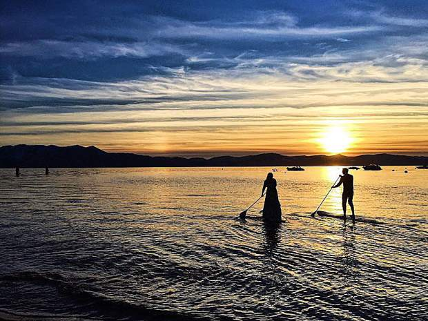 When tying the knot on the shores of Lake Tahoe, why not take a paddleboard to Big Blue for the best view of the sunset?