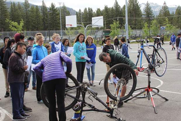 "In the spirit of the Tahoe Bike Challenge, South Tahoe Middle School partnered with local cycling groups, Tahoe Regional Planning Agency, the Boys and Girls Club and several other organizations to host the first STMS ""bike rodeo."" At the event, students learned anything from bike safety and maintenance to the environmental impact riding a bike can have. The students also had some fun with obstacle courses. Pictured: Joe Marzocco, of TRPA, shows students how to make sure their bike is properly maintained and ready to roll."