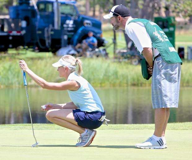 Kathryn Tappen lines-up her putt on the 18th green Friday at Edgewood.