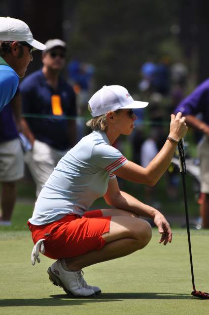 Golf Channel broadcaster Lisa Cornwell assesses a put Friday.