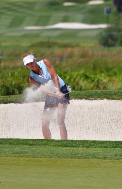 Sportscaster Kathryn Tappen hits a shot from a sand trap Friday.