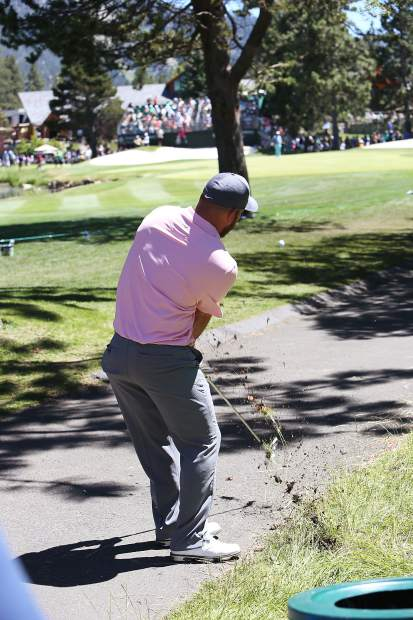 Chad Pfeiffer hits from the rough along the 18th fairway Saturday afternoon.