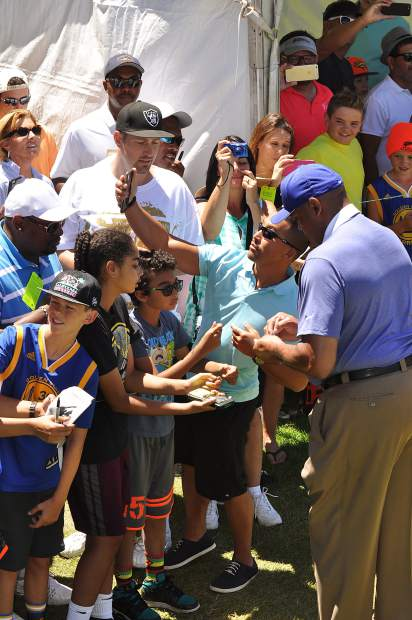 NBA great Charles Barkley signs autographs for fans Saturday.