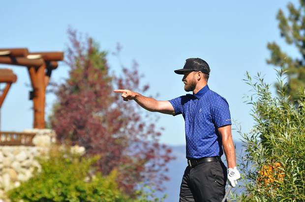 A pointing Justin Timberlake maintains a serious demeanor.