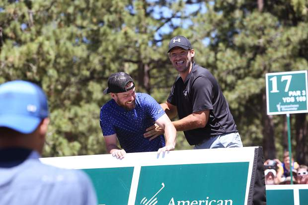 Justin Timberlake and Tony Romo horse around before teeing off on the 17th Saturday afternoon at Edgewood.