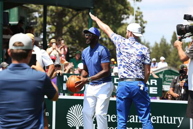 Justin Timberlake attempts to block Jerry Rice's basketball shot on the 17th Friday.