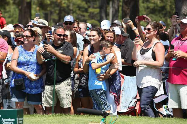 A fan and his mother are ecstatic after getting Steph Curry's autograph Friday on the 17th hole.