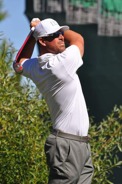 Former MLB pitcher Mark Mulder watches his drive from the tee box.