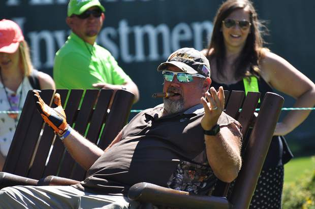 Larry the Cable Guy takes a break from playing golf Saturday.