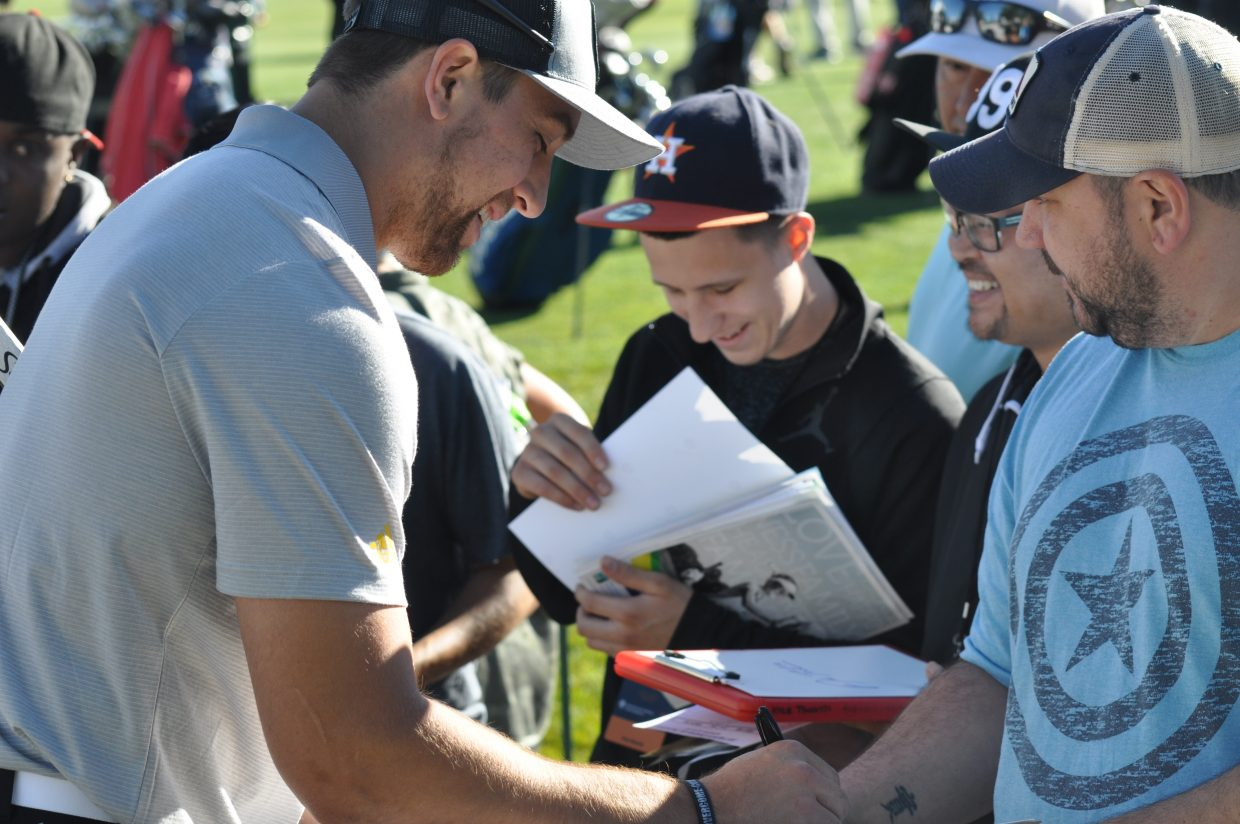 Adam Thielen, wide receiver for the Minnesota Vikings, signs autographs at Edgewood Tahoe Wednesday.