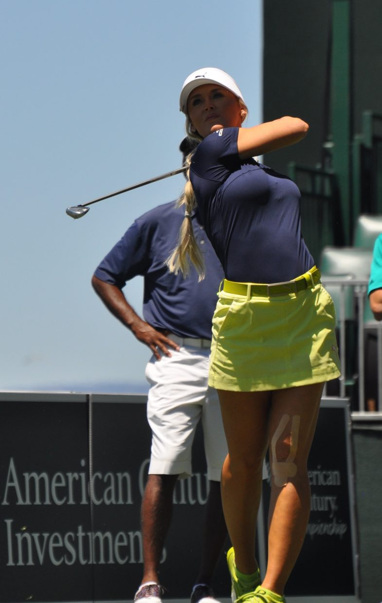 Golfer and professional model Blair O'Neal pauses after her shot Wednesday.
