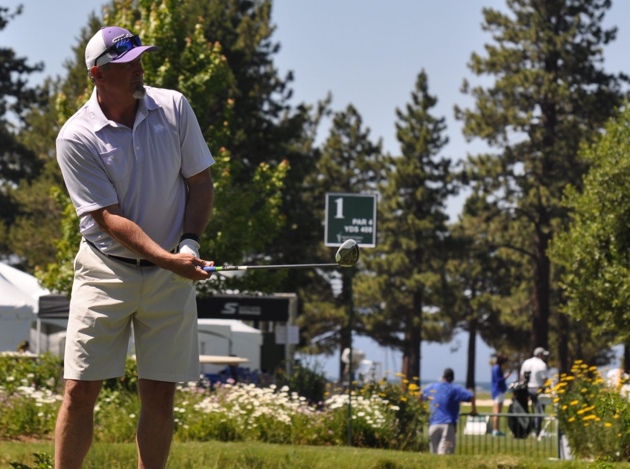 Former MLB pitcher Bret Saberhagen takes a swing Wednesday.