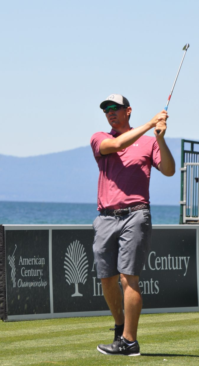 NHL goaltender Carey Price looks on at his shot from the tee box Wednesday.