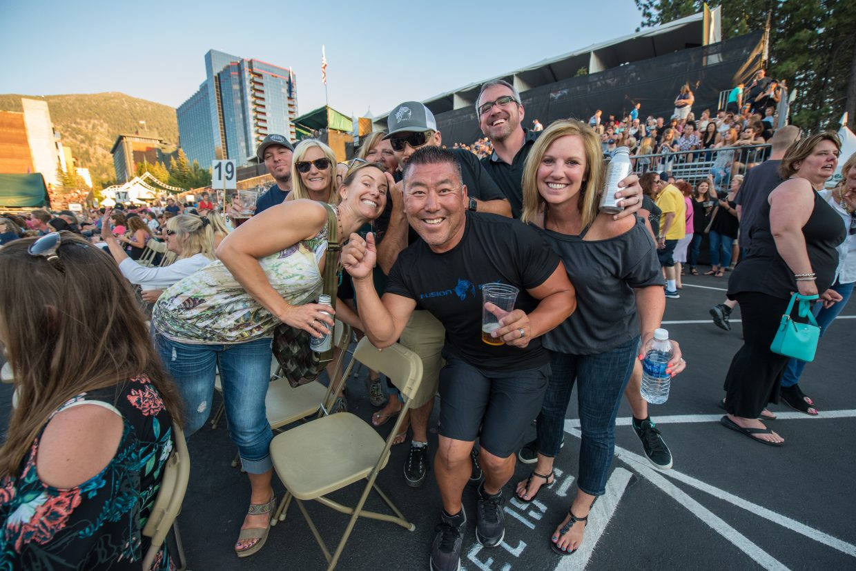 Fans having a good time before Train takes the stage at the Harveys Lake Tahoe outdoor concert venue on Sunday, July 9.