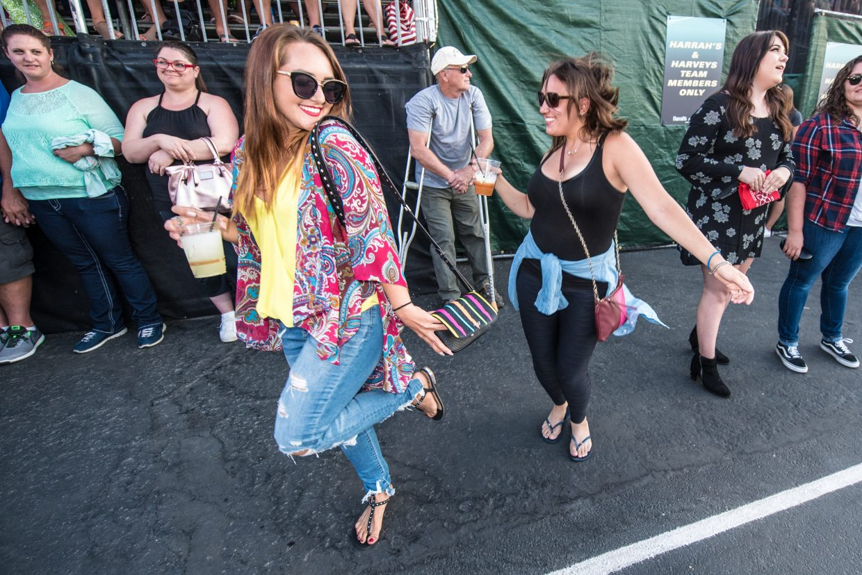 Concert goers showing they're the life of the party at the Harveys Lake Tahoe outdoor concert venue on Sunday, July 9th.