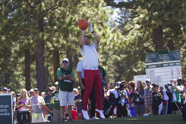 Former NBA great and current coach Jason Kidd takes a jump shot on hole 17.