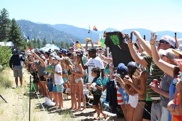 Fans line the beach along the 17th tee Saturday as Justin Timberlake, Tony Romo and Steph Curry prepare to tee off.