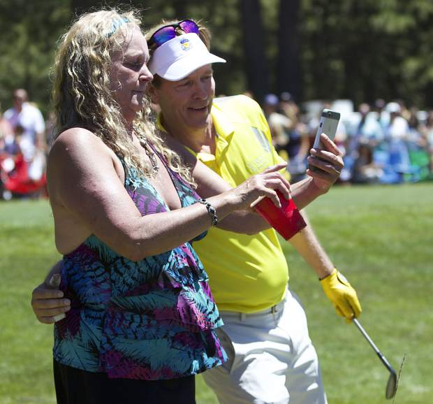 Actor Jack Wagner poses for a selfie on hole 17.