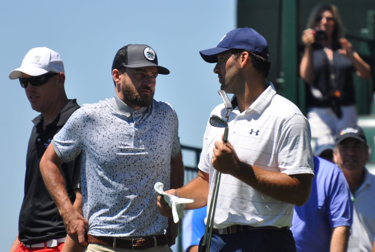 Justin Timberlake and Tony Romo chat during a practice round at Edgewood Tahoe Wednesday.
