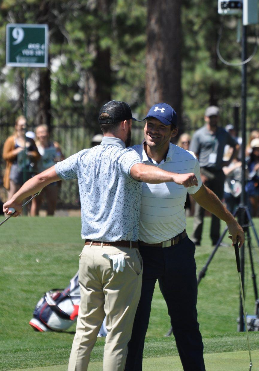 Justin Timberlake and Tony Romo go for a chest bump Wednesday.