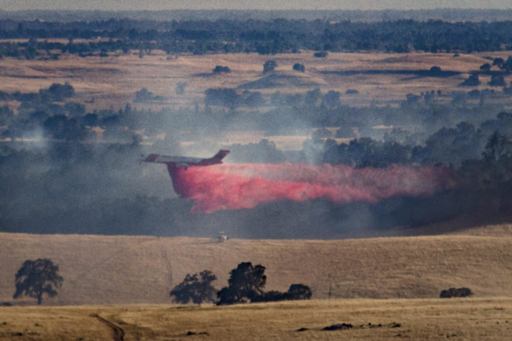 A DC-10 drops fire retardant on the Latrobe Fire Wednesday evening.