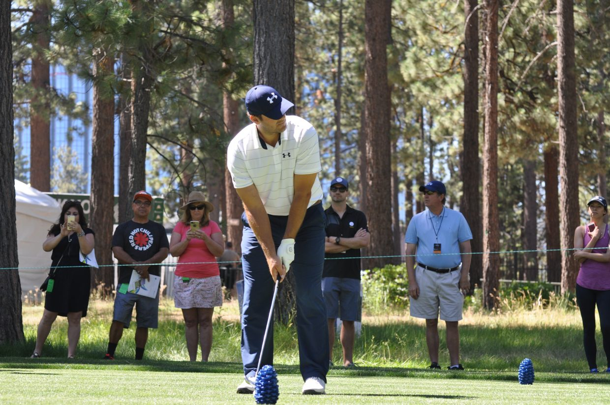 Tony Romo squares up for a shot Wednesday at Edgewood Tahoe.
