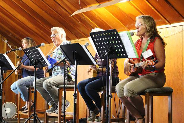Four players from the South Shore Ukulelians lead the group in the two-hour jam session.