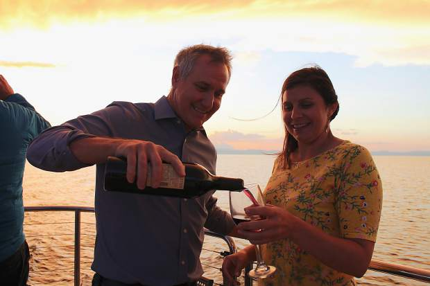 Van Ruiten Family Winery VP of sales and marketing Dave Moore pours a glass of wine for Tribune account manager Annemarie Prudente.