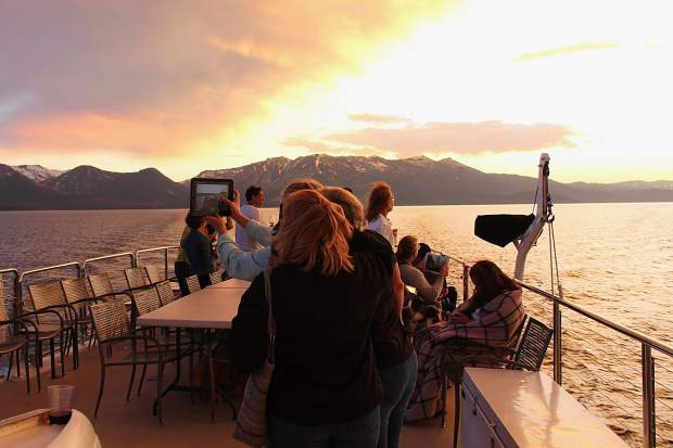 The sunset tranforms the water on a wine cruise aboard the Safari Rose on Wednesday, June 21.