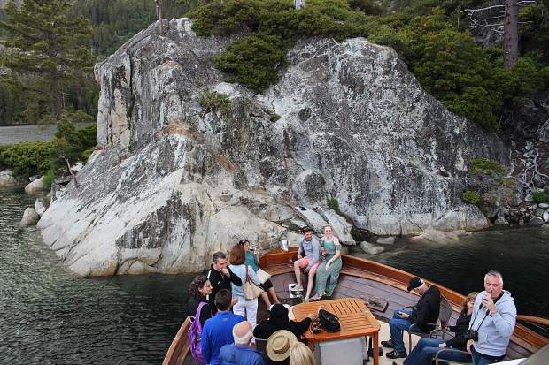 The captain of the Safari Rose noses the boat up to Fannette Island in Emerald Bay.