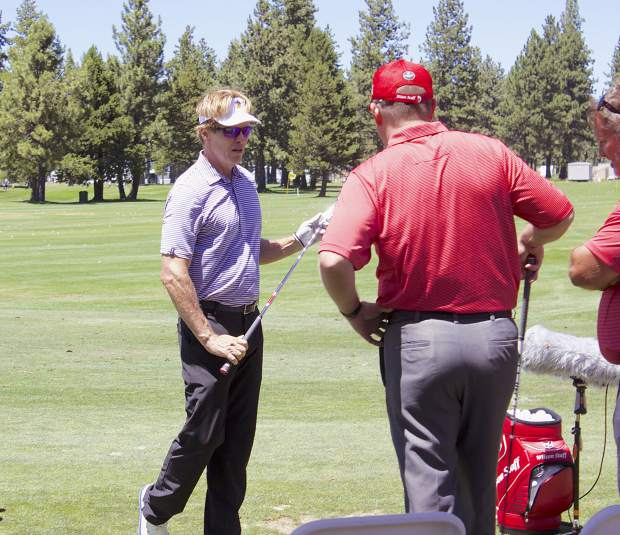 ACC tournament veteran Jack Wagner stopped by Wilson Golf's tent Tuesday for a few practice swings on their clubs.