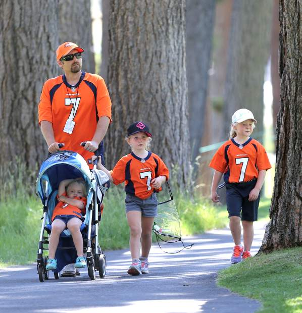 John Elway fan Richard O'Roark strolls through the Edgewood Tahoe Golf Course on Tuesday with his three daughters, Sawyer, 3, Reagyn, 5, and Elyn, 7.