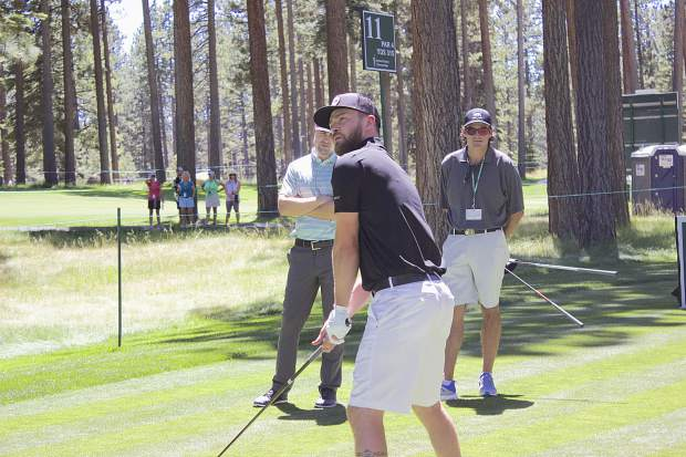 Justin Timberlake squares up at Edgewood's 1th hole, Tuesday, for a few practice rounds at the 2017 ACC celebrity golf tournament.