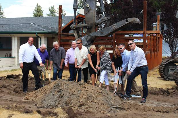 Members of city council and officials with Halferty Development and Whole Foods shovel dirt on the site of the new commercial development, which is expected to be completed next spring.