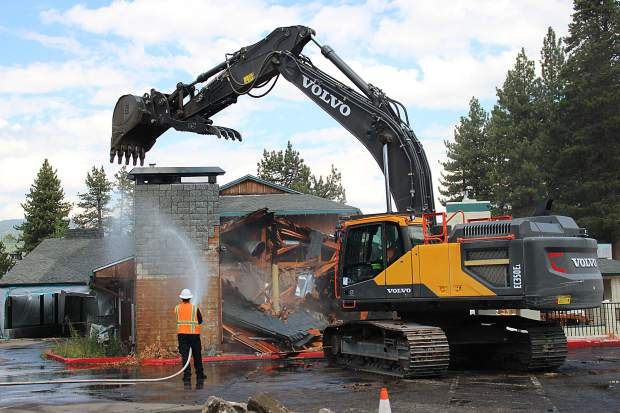 An excavator tears down a portion of the Knights Inn at the groundbreaking ceremony for the future Bijou Marketplace.