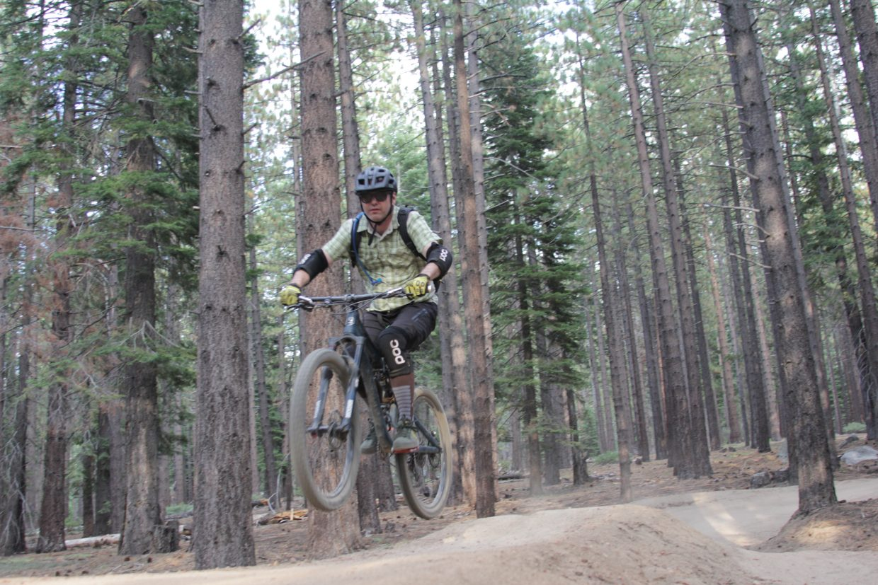 A biker catches some air on the Corral Trail.