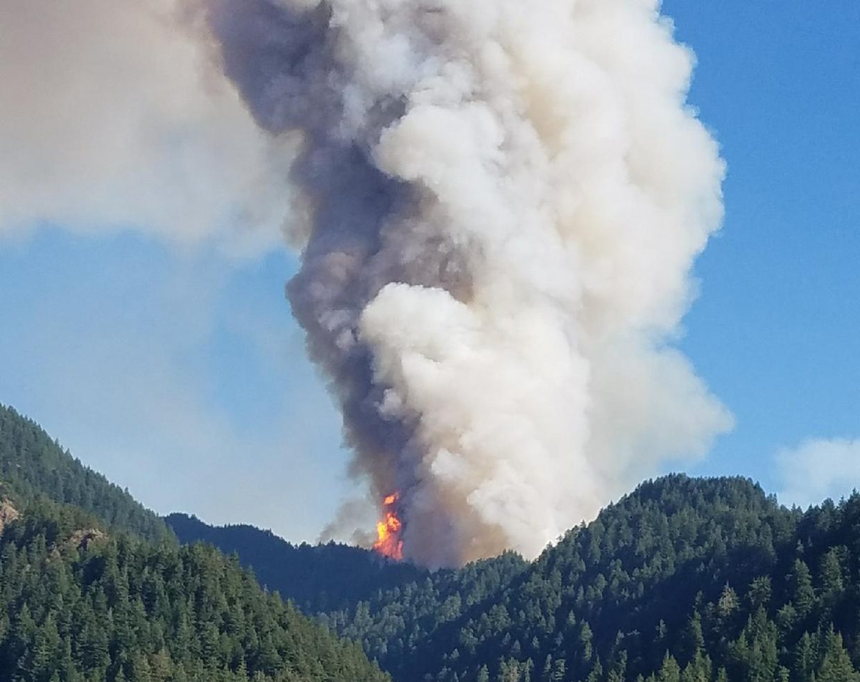 In this Saturday, Sept. 2, 2017, photo provided by Inciweb, the Eagle Creek wildfire burns in the Columbia River Gorge east of Portland, Ore. A lengthy stretch of highway Interstate 84 remains closed Tuesday, Sept. 5, 2017, as crews battle the growing Eagle Creek wildfire that has also caused evacuations and sparked blazes across the Columbia River in Washington state. (Inciweb via AP)