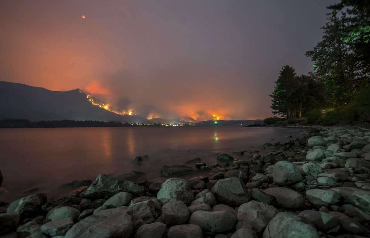 This Monday, Sept. 4, 2017, photo provided by KATU-TV shows a wildfire as seen from near Stevenson Wash., across the Columbia River, burning in the Columbia River Gorge above Cascade Locks, Ore. A lengthy stretch of highway Interstate 84 remains closed Tuesday, Sept. 5, as crews battle the growing wildfire that has also caused evacuations and sparked blazes across the Columbia River in Washington state. (Tristan Fortsch/KATU-TV via AP)