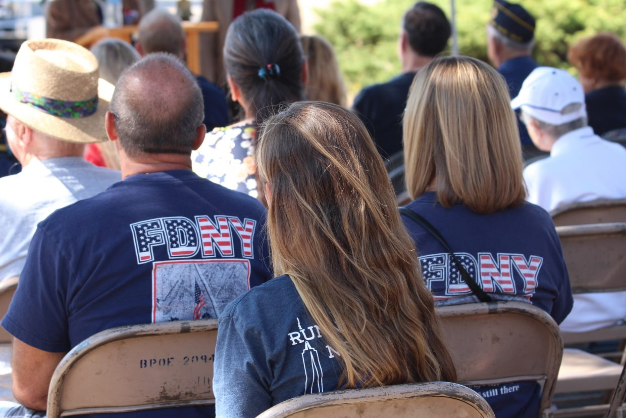 Two ceremony attendees wore New York City Fire Department T-shirts.