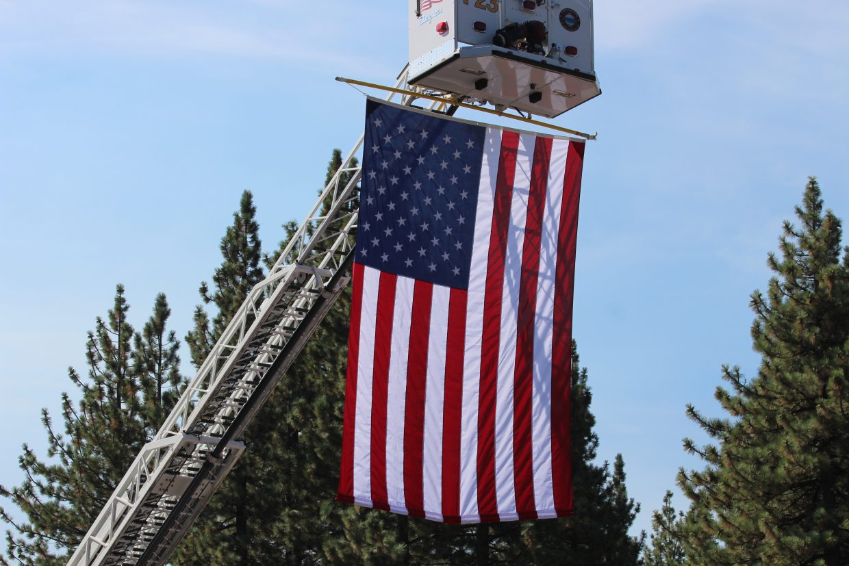 A large American flag hung from the crane of a fire truck during a previous ceremony on Sept. 11.