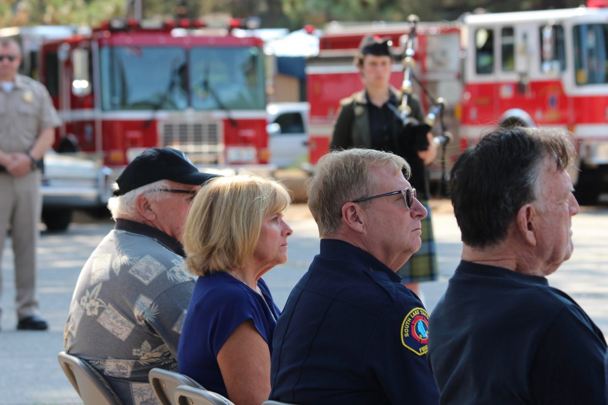 South Lake Tahoe councilmember Tom Davis, Mayor Pro Tem Wendy David and SLTFR Chief Jeff Meston listen to the speeches at the Sept. 11 ceremony held at the American Legion.