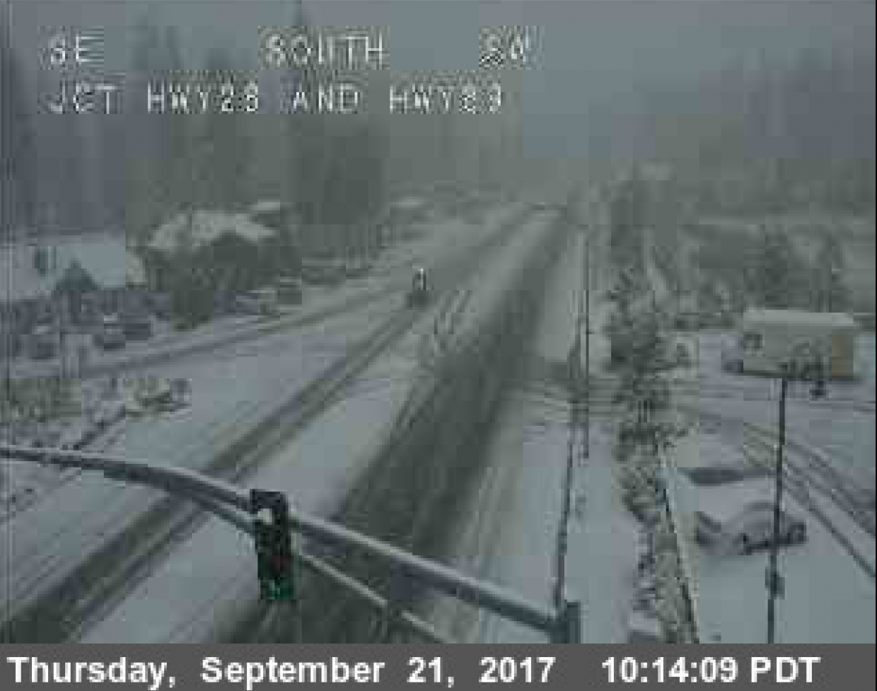 This screen shot of a Caltrans traffic camera shows light snow accumulation in Tahoe City Thursday morning.