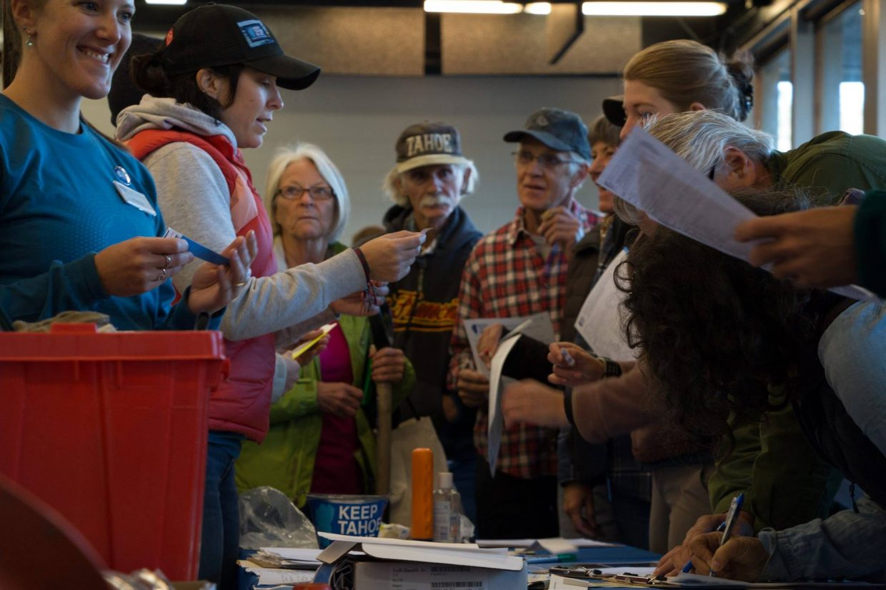 Many volunteers show up to sign in Saturday.