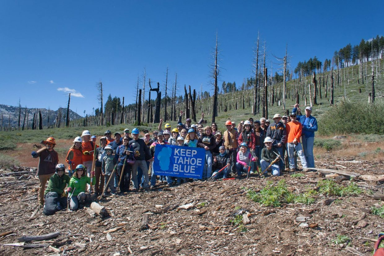 Volunteers wrap up the day's work at the Angora burn site.