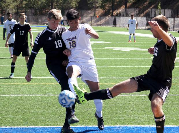 South Tahoe's Armando Rosales battles two Spring Creek defenders Saturday to put a shot on goal.
