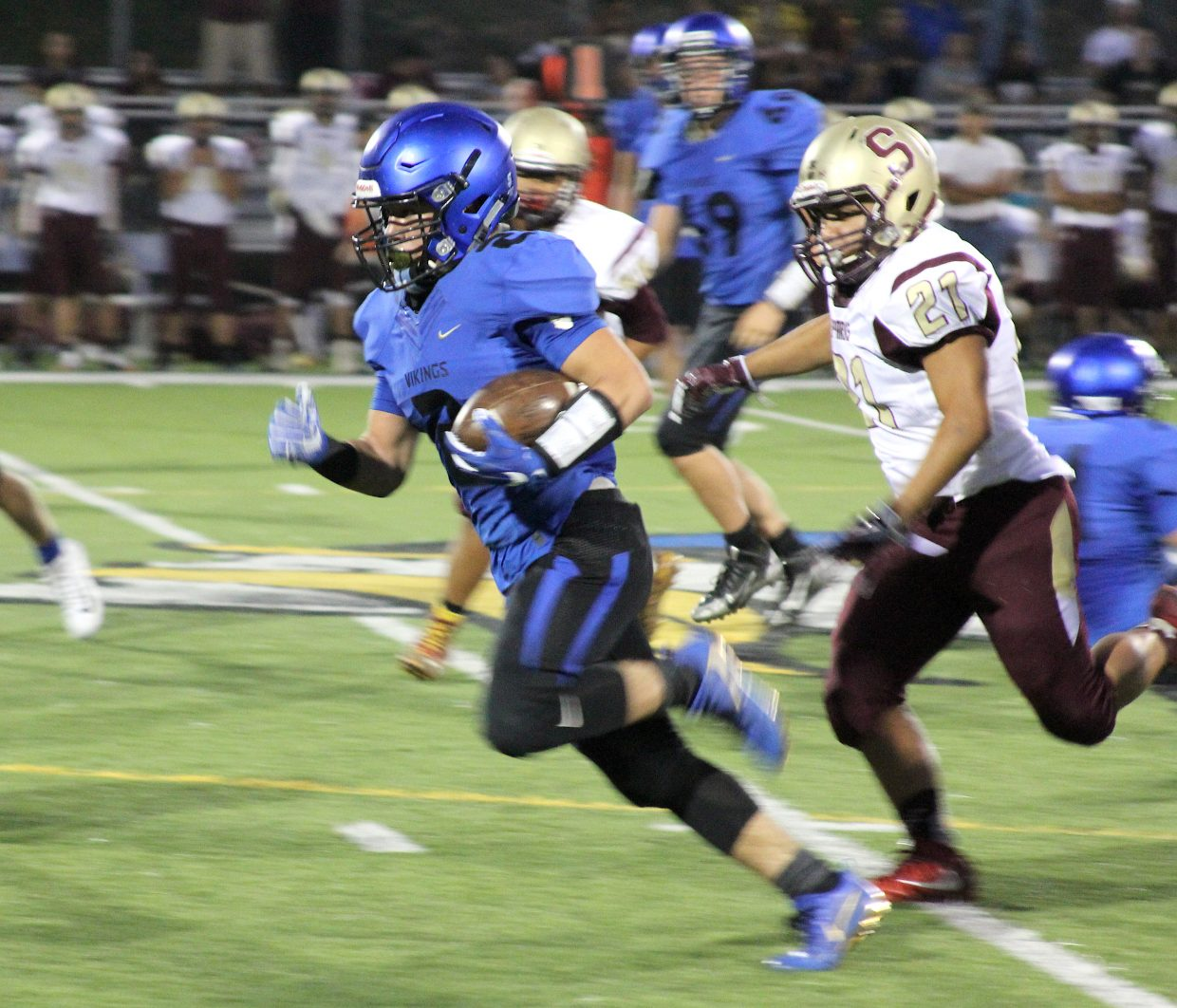 South Tahoe's Jakob Costley runs for a big gain Friday night against Sparks. Costley scored three times and rushed for over 10 yards per carry.