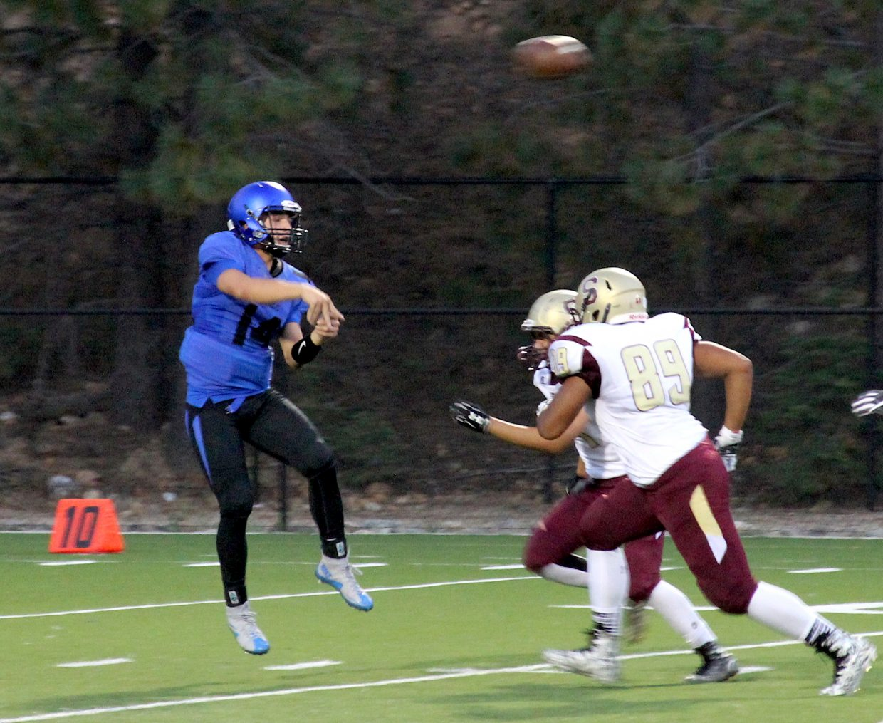 Viking quarterback Peyton Galli passes before Sparks defenders can bring him down. Galli threw for 226 yards and three touchdowns.